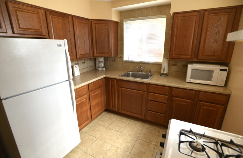 Full Kitchen - massive 5 room Two Bedroom apartment suite at Friendship Suites.
