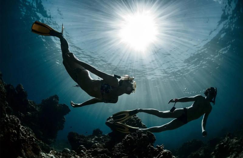 Scuba diving at Lund Resort at Klah ah men.