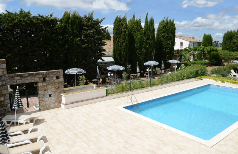 Outdoor pool at Le Relais du Val d'Orbieu.