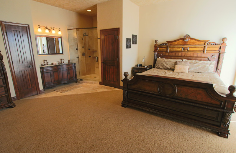 Suite bedroom at D'Monaco Luxury Resort.