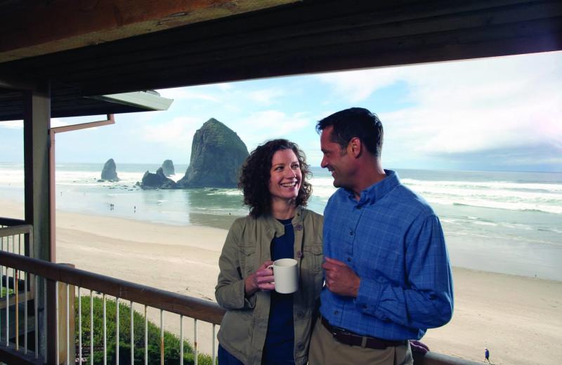 Couple on balcony at Hallmark Resort in Cannon Beach.