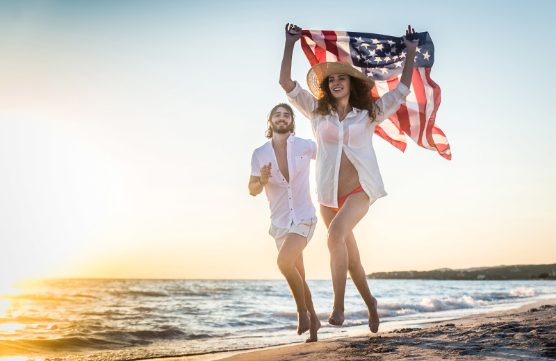 Couple on beach at Amelia Rentals and Management Services.