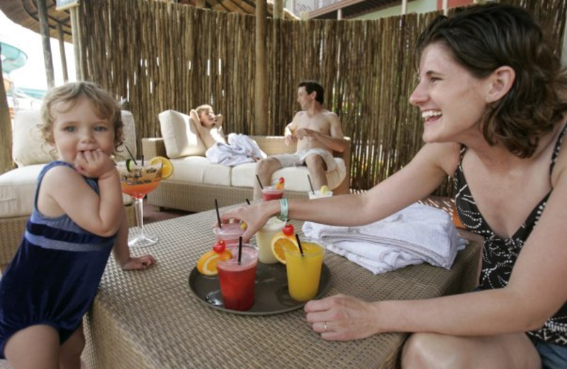 Family in cabana at Kalahari Waterpark Resort Convention Center.