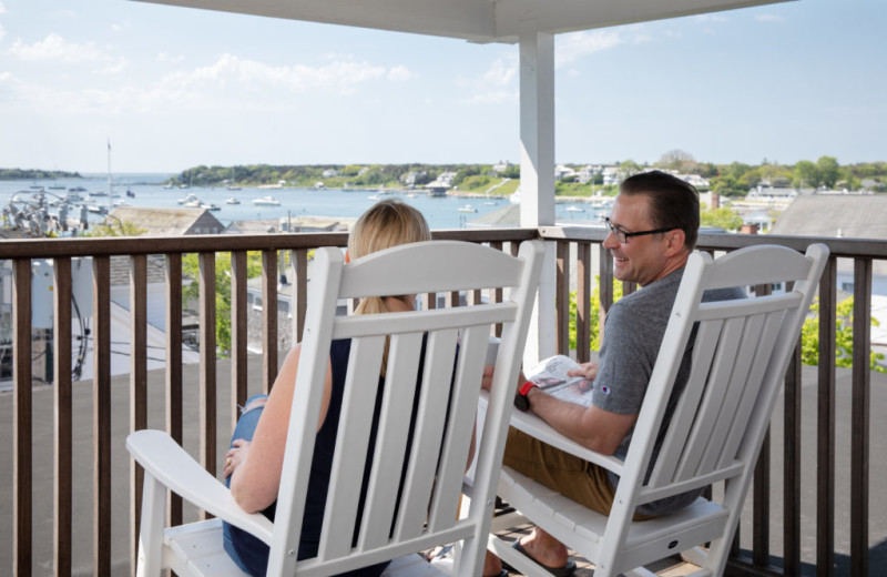 Couple on balcony at Vineyard Square Hotel & Suites.