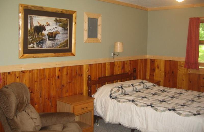 Cabin bedroom at Finn'n Feather Resort.