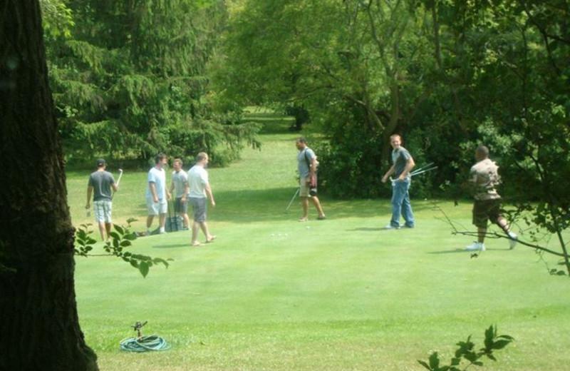 Playing golf at Island Club Rentals.