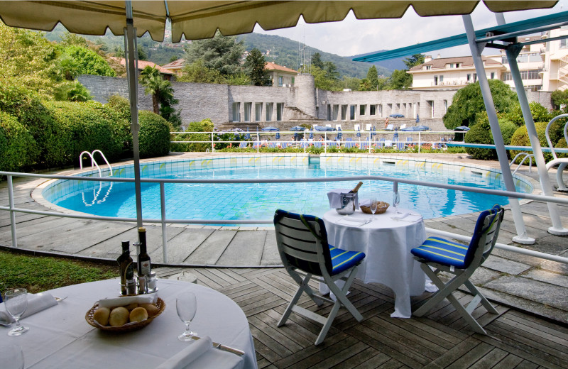 Poolside dingn at Grand Hotel des Iles Borromees.