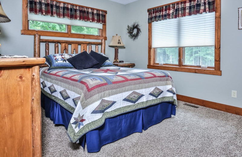 Cabin bedroom at Hampel Properties.