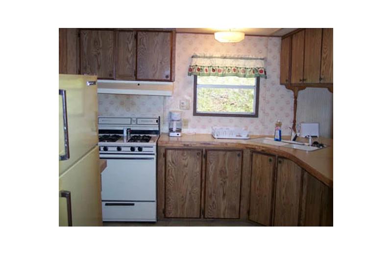 Cabin kitchen at Hocking Hills Cozy Cabins.