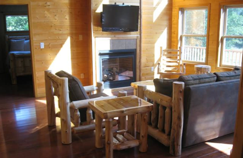 Moonlight Bend cabin Great Room at Red Cedar Lodge features a gas fireplace ~ perfect for cool summer nights or frosty winter mornings.