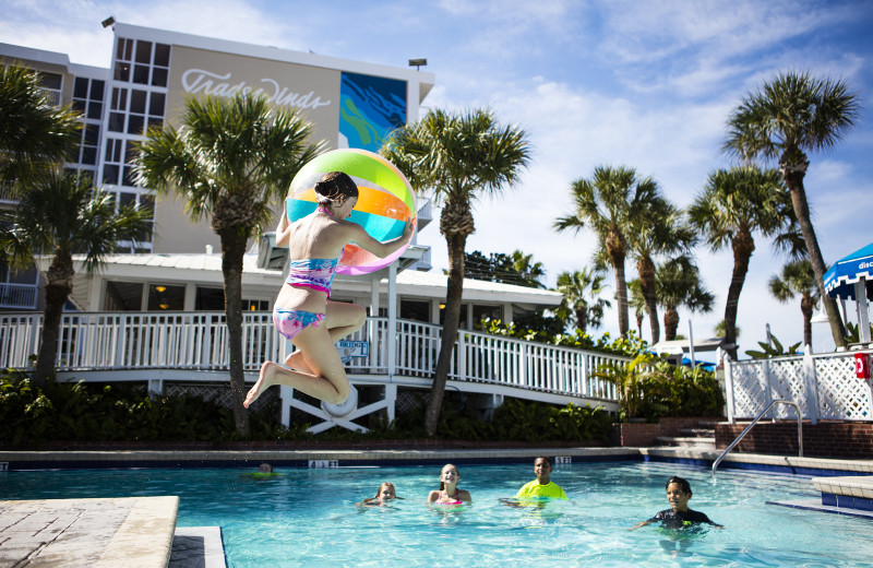 Jumping in pool at TradeWinds Island Grand.