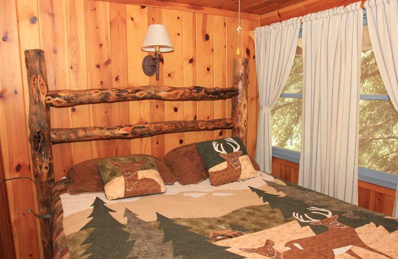 Cabin bedroom at Pine River Lodge.