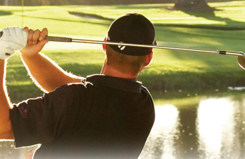Playing golf at Quail Lodge Resort.