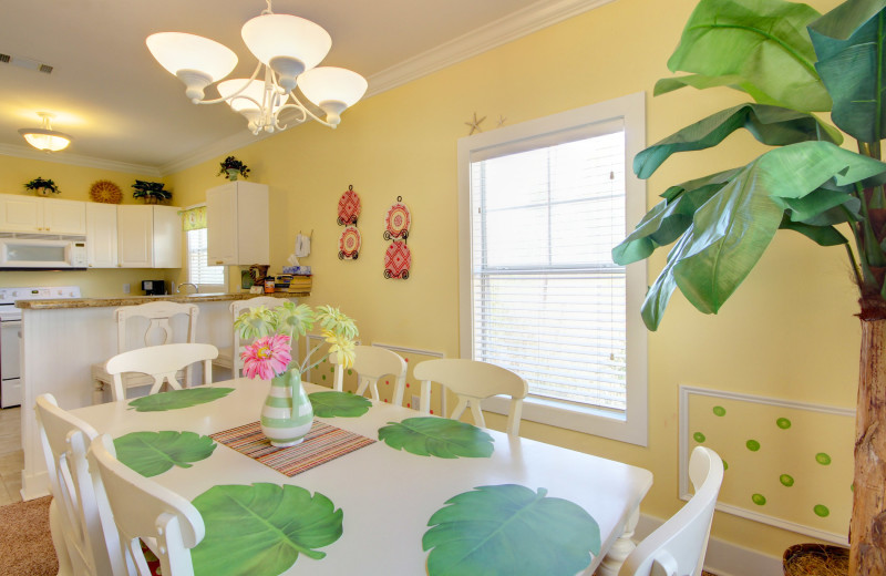 Rental kitchen and dining room at Perdido Key Resort Management.