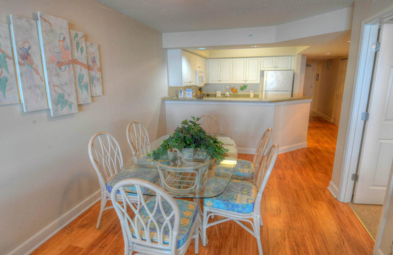 Rental kitchen at CondoLux Vacation Rentals.