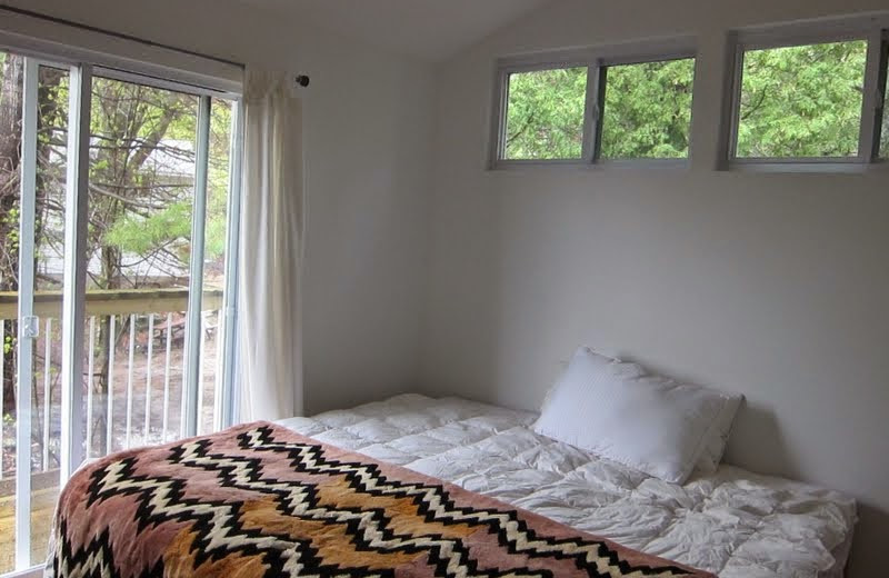 Cottage bedroom at Bob's Lake Cottages.