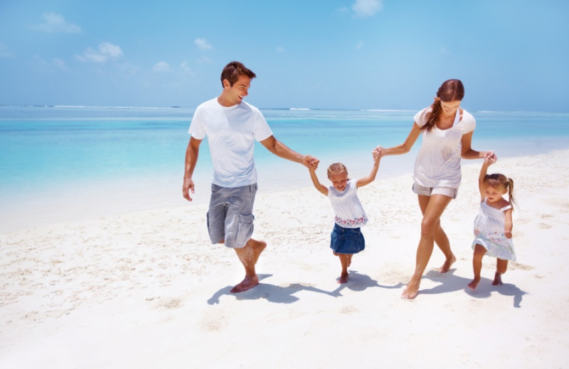 Family walking on beach at Marco Escapes.