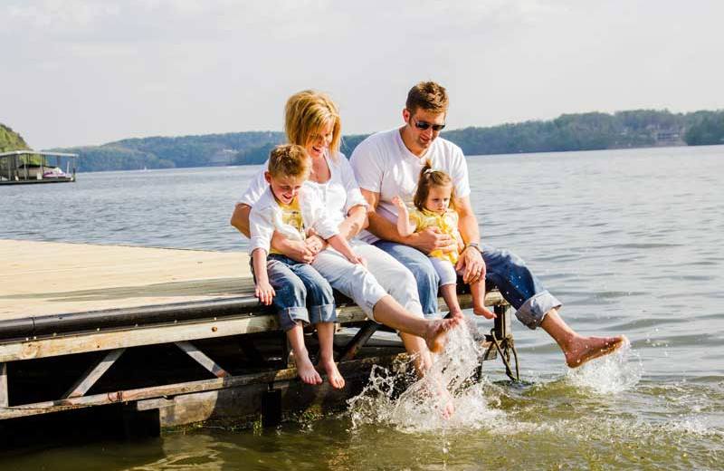 Family on the dock at Sunset Inn Resort.