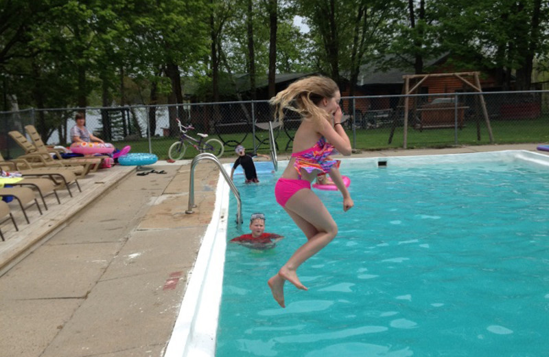 Jumping in pool at Cedar Point Resort.