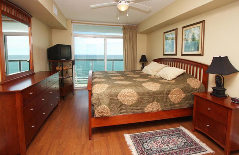 Rental bedroom at MyrtleBeachVacationRentals.com.