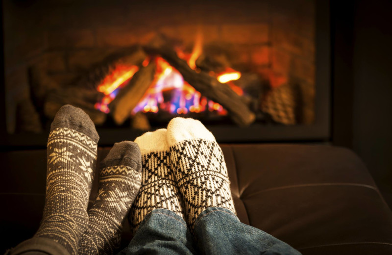 Couple by fire at Alpine Getaways.