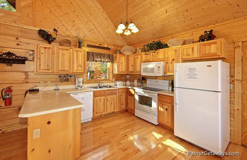 Vacation home kitchen at American Patriot Getaways, LLC.