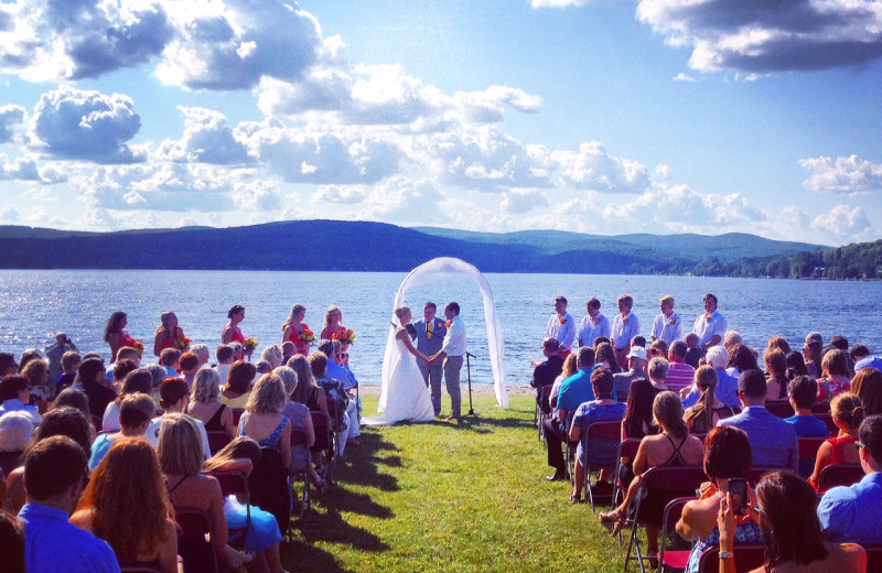 Lakeside backdrop on the beautiful clean sandy beach of Jackson's Lodge on pristine international Lake Wallace, Canaan, Vermont makes a memorable picture-perfect wedding ceremony.
