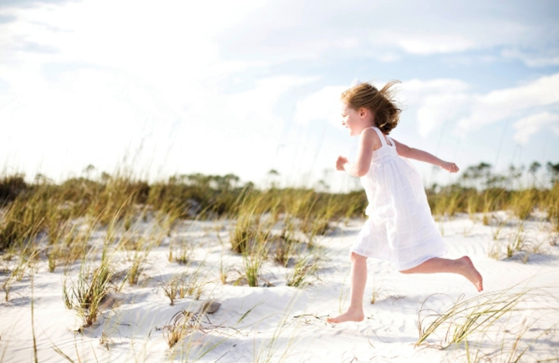 Running on the beach at Newman-Dailey Resort Properties, Inc.