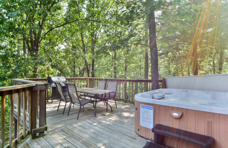 Rental deck and hot tub at Amazing Branson Cabin Rentals - RentBranson.