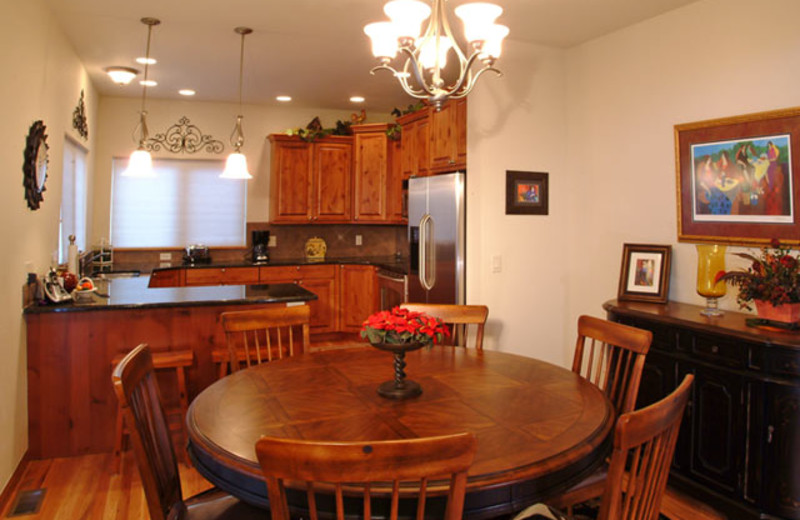 Vacation rental dining and kitchen at Marys Lake Vacation Condos.