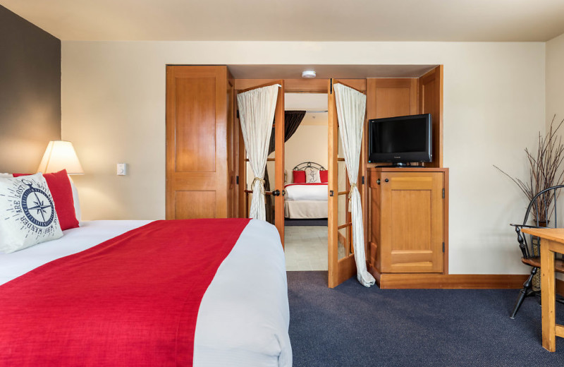 The main room has a king size bed, gas fireplace, microwave, jetted Jacuzzi tub and shower combination with an adjoining side room includes a queen bed, sitting chair and writing desk.