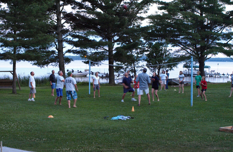 Family playing volleyball at Wind Drift Resort.