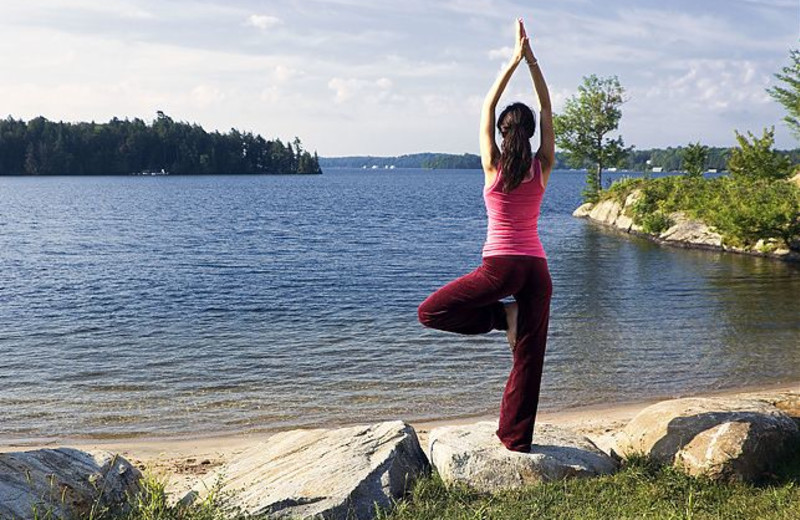 Yoga by the lake at JW Marriott The Rosseau Muskoka Resort & Spa.