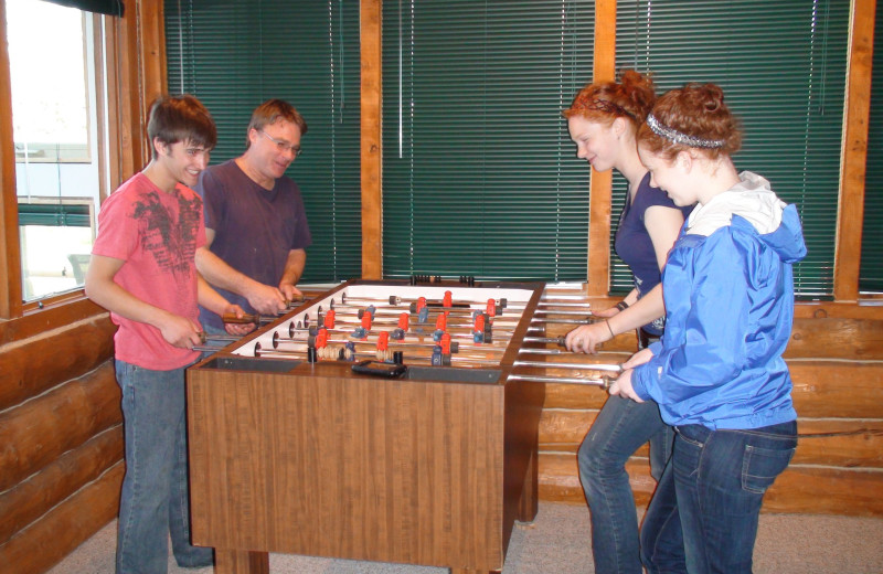 Family playing Foosball at Bear Paw Adventure.