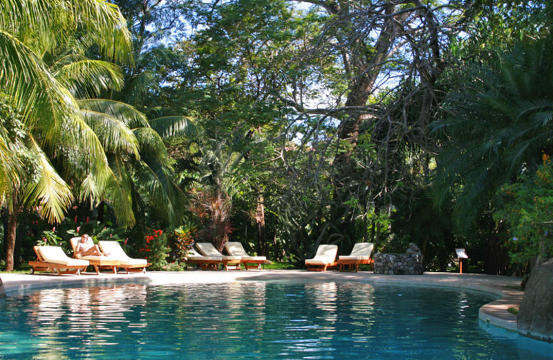 Outdoor pool at Hotel Capitán Suizo.