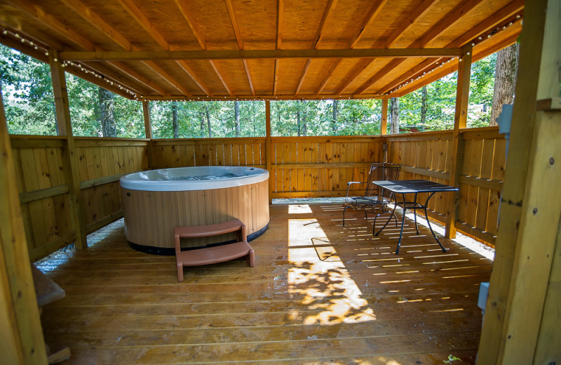 Cabin hot tub at Kiamichi Country Cabins.