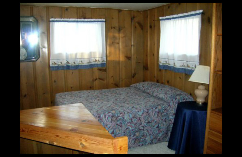 Cabin bedroom at Lighthouse Lodge Resort.