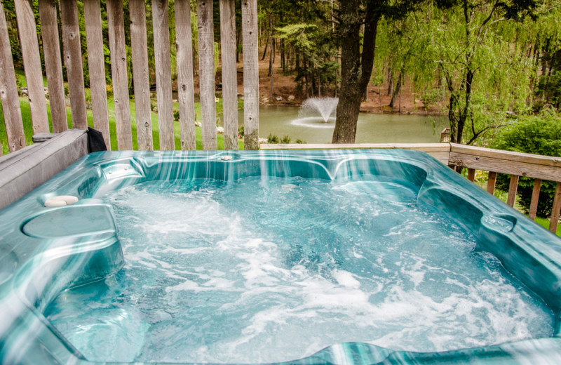 Cabin hot tub at Asheville Cabins of Willow Winds.
