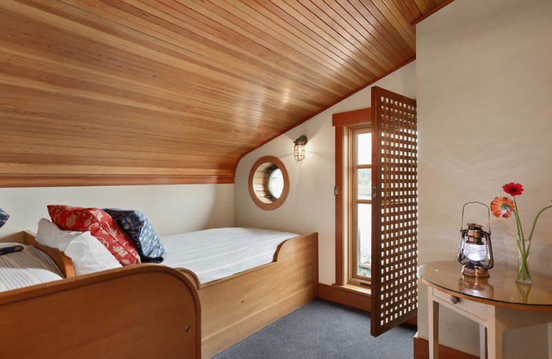 This is the side room to the Captains Suite including two twin beds and a view of the channel.