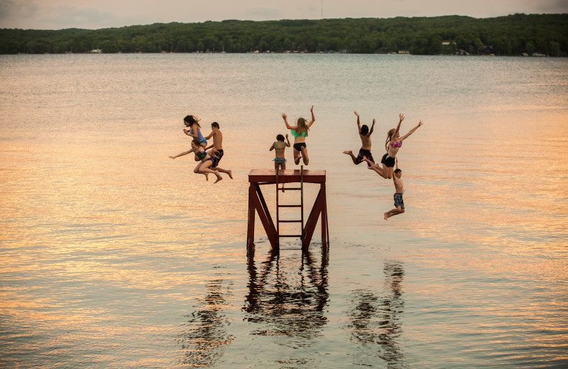 Jumping in lake at Fair Hills Resort.