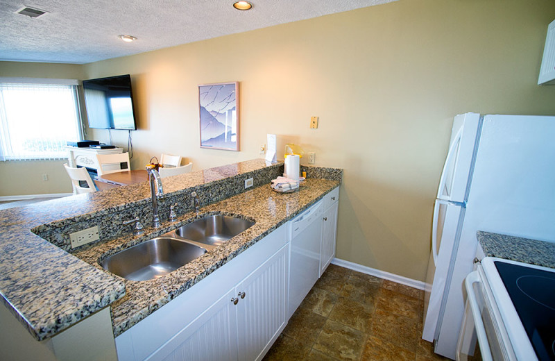 Condo kitchen at The Beach Condominiums Hotel-Resort.
