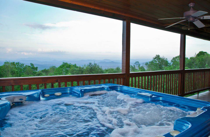 Deck jacuzzi at Mountain Getaway Cabin Rentals.