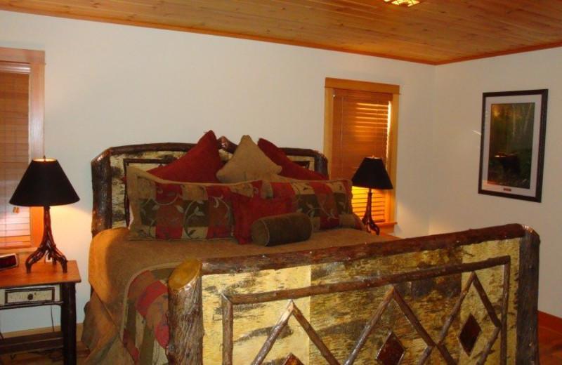 Vacation rental bedroom at Lake Placid Vacation Homes.