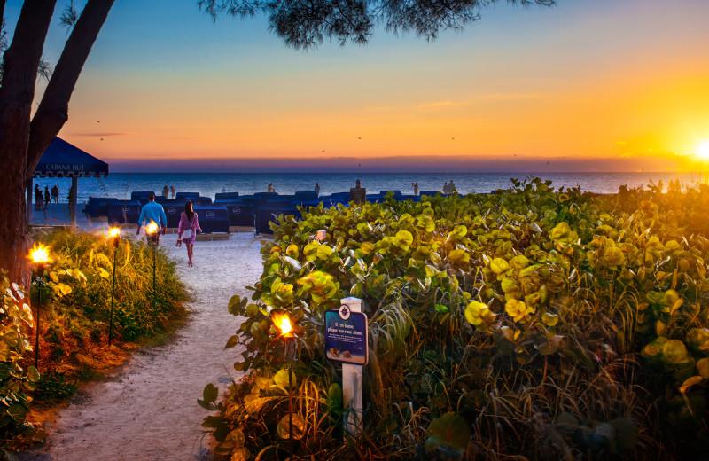 Beach sunset at TradeWinds Island Grand.