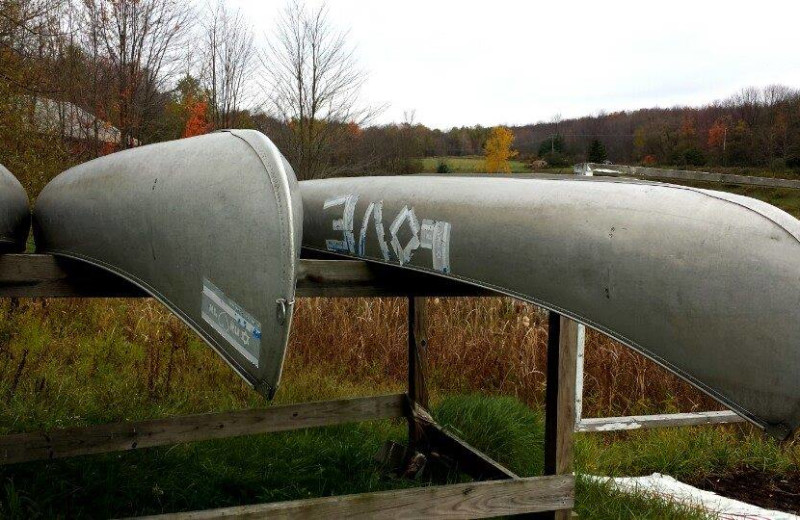 Canoes at The Woods At Bear Creek Glamping Resort.
