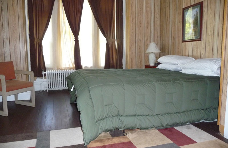 Guest bedroom at The Elms Waterfront Cottages.