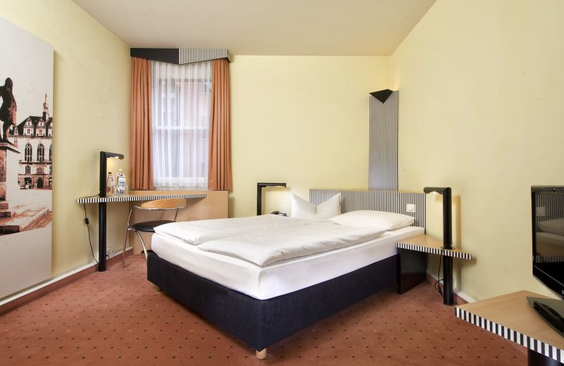 Guest room at TRYP by Wyndham Halle Hotel.