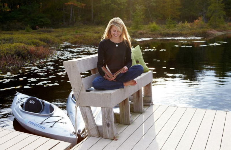 Reading by the lake at The Lodge at Woodloch.