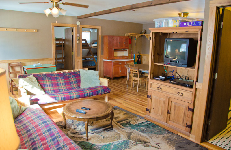 Cabin living room at Tri Lake Timbers Resort.