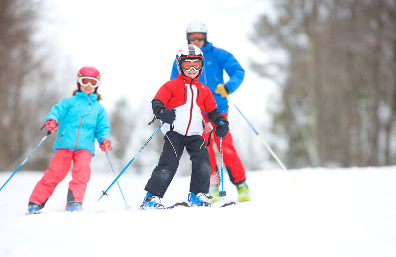 Family skiing at Sunapee Harbor Cottages.